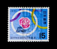 Rose and Rings, Campaigns, Milestone Events and Anniversaries serie, circa 1971. MOSCOW, RUSSIA - NOVEMBER 23, 2017: A stamp printed in Japan shows Rose and Stock Photo