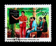 Education for adults, International illiteracy year serie, circa. MOSCOW, RUSSIA - NOVEMBER 25, 2017: A stamp printed in Lao People's Democratic Republic shows Stock Photography