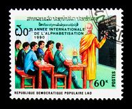 Education for adults, International illiteracy year serie, circa. MOSCOW, RUSSIA - NOVEMBER 25, 2017: A stamp printed in Lao People's Democratic Republic shows Stock Photo
