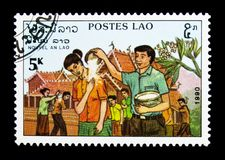 New Year, serie, circa 1990. MOSCOW, RUSSIA - NOVEMBER 25, 2017: A stamp printed in Lao People's Democratic Republic shows New Year, serie, circa 1990 Royalty Free Stock Images
