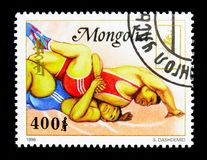 Fight, Summer Olympics 1996, Atlanta serie, circa 1996. MOSCOW, RUSSIA - NOVEMBER 26, 2017: A stamp printed in Mongolia shows Fight, Summer Olympics 1996 Royalty Free Stock Photos