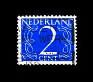 Numeral, Numbers serie, circa 1946. MOSCOW, RUSSIA - NOVEMBER 25, 2017: A stamp printed in Netherlands shows Numeral, Numbers serie, circa 1946 Royalty Free Stock Photo