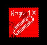Paperclip, Norwegian Inventions serie, circa 1999. MOSCOW, RUSSIA - NOVEMBER 25, 2017: A stamp printed in Norway shows Paperclip, Norwegian Inventions serie Stock Photography