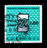 International Labour Organisation, 50th Anniversary, serie, circ. MOSCOW, RUSSIA - NOVEMBER 24, 2017: A stamp printed in Portugal shows International Labour Stock Image
