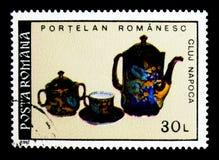Porcelain - Tea Service, Romanian Porcelain serie, circa 1992. MOSCOW, RUSSIA - NOVEMBER 25, 2017: A stamp printed in Romania shows Porcelain - Tea Service Royalty Free Stock Photos