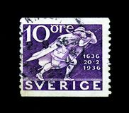 Post Runner, 300th Anniversary of Swedish Postal Service serie, circa 1936. MOSCOW, RUSSIA - NOVEMBER 23, 2017: A stamp printed in Sweden shows Post Runner Royalty Free Stock Image