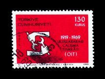 International Labour Organisation, 50th anniversary serie, circa. MOSCOW, RUSSIA - NOVEMBER 26, 2017: A stamp printed in Turkey shows International Labour Royalty Free Stock Photo