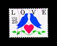 Two birds and heart, Love Issue, circa 1990. MOSCOW, RUSSIA - NOVEMBER 24, 2017: A stamp printed in USA shows Two birds and heart, Love Issue, circa 1990 Royalty Free Stock Photos