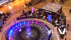 MOSCOW, RUSSIA - NOVEMBER, 25. Starbucks coffee cafe near big fountain in the shopping mall 4K video stock footage