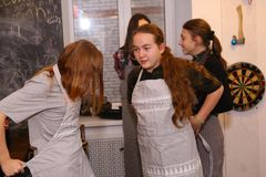 Teenager kids team cooking having fun. Moscow, Russia, November 21, 2017: Unidentified teenager kids cooking pasta on culinary master class - happy event Stock Images
