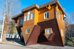 Moscow, Russia-November 06: An Upside-down house in VDNKh park,an upside-down car parked in the driveway on November 06,2015. Everything is upside down inside royalty free stock photo