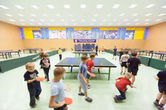 Children's classes in ping pong i Stock Photos