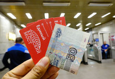 Hand holding a train ticket in Moscow, Russia. Moscow, Russia - Oct 3, 2016. Hand holding train tickets with money in Moscow, Russia. Moscow is the capital and Royalty Free Stock Photo