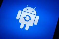 Android robot logo icon on the smart phone screen during update installation Stock Image