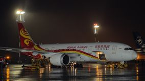 Boeing 787-8 of Hainan Airlines in Sheremetyevo Airport at night. MOSCOW, RUSSIA - OCTOBER 31, 2017: Boeing 787-8 Dreamliner of Hainan Airlines being prepared stock video