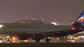 Sheremetyevo Airport with Terminal F and Aeroflot planes a night, Moscow stock footage