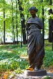 A lone broken female statue in the park of the former manor in Moscow royalty free stock image