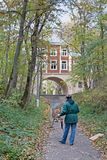 Man painting building with arch in the autumn museum-estate `Arkhangelsk` in Moscow royalty free stock photos