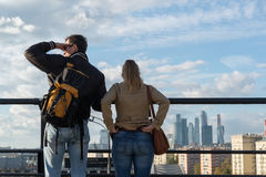 Moscow, Russia-October 01.2016. Man and woman on viewing platform looking at Moscow City. Moscow, Russia-October 01.2016. Man and woman on a viewing platform Stock Photography