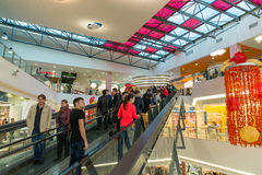 Moscow, Russia - October 01.2016. People on escalator in the shopping and entertainment center Gagarin Royalty Free Stock Images