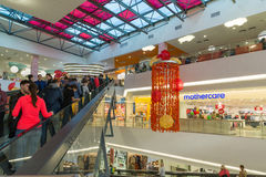 Moscow, Russia - October 01.2016. People on escalator in the shopping and entertainment center Gagarin Royalty Free Stock Photo