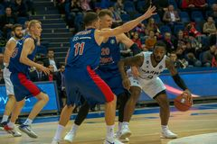 Defense holding back attacker. MOSCOW, RUSSIA - OCTOBER 29, 2018: Rashard Kelly 0 in a basketball game CSKA vs Parma Perm on the regular championship of the VTB royalty free stock photography