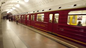 Moscow, Russia-October 9.2016. Red Arrow - nominal train in subway Okhotny Ryad. Moscow, Russia-October 9.2016. Red Arrow - nominal train in the subway stock footage