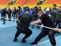 Riot policemen compete in tug of war stock photos