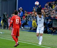 Russian midfielder Aleksandr Samedov and South Korean midfielder. Moscow, Russia - October 7, 2017. Russian midfielder Aleksandr Samedov and South Korean Royalty Free Stock Photos