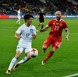 Russian midfielder Konstantin Rausch and South Korean winger Chu Stock Images