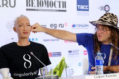 Sophia humanoid robot at Open Innovations Conference at Skolokovo technopark. Moscow, Russia - October 1, 2017: Sophia humanoid robot and Dr. Ben Goertzel, CEO Royalty Free Stock Images