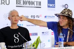 Sophia humanoid robot at Open Innovations Conference at Skolokovo technopark. Moscow, Russia - October 1, 2017: Sophia humanoid robot and Dr. Ben Goertzel, CEO Royalty Free Stock Image