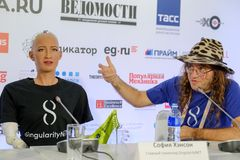 Sophia humanoid robot at Open Innovations Conference at Skolokovo technopark. Moscow, Russia - October 1, 2017: Sophia humanoid robot and Dr. Ben Goertzel, CEO Royalty Free Stock Photo