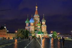Moscow, Russia. October 4, 2018: St. Basil`s Church in Red Square, Moscow at Night with crowds walking around. View as royalty free stock photo