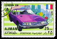 Citroen SM, Sports cars serie, circa 1971. MOSCOW, RUSSIA - OCTOBER 21, 2018: A stamp printed in Ajman shows Citroen SM, Sports cars serie, circa 1971 stock photo