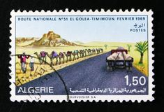 MOSCOW, RUSSIA - OCTOBER 1, 2017: A stamp printed in Algeria shows Route El Golea to Timimoun, Sahara Development serie, circa. 1969 royalty free stock photos