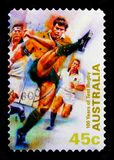 Kicking Ball, Test Rugby serie, circa 1999. MOSCOW, RUSSIA - OCTOBER 3, 2017: A stamp printed in Australia shows Kicking Ball, Test Rugby serie, circa 1999 royalty free stock photos