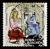 MOSCOW, RUSSIA - OCTOBER 21, 2017: A stamp printed in German Fed. Eral Republic shows scene from Sleeping Beauty – The spindle , Welfare: Grimms Fairy Tales Stock Photos