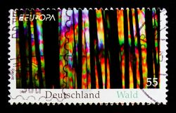 MOSCOW, RUSSIA - OCTOBER 21, 2017: A stamp printed in German Fed. Eral Republic shows Incidence of light in the wood, serie, circa 2011 Stock Photo