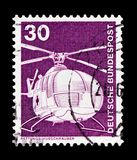 Rescue helicopter MBB, Industry and Technology Definitives 1975-1982 serie, circa 1975. MOSCOW, RUSSIA - OCTOBER 21, 2017: A stamp printed in German Federal stock photo