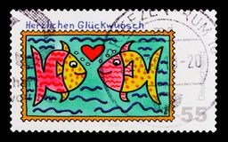 MOSCOW, RUSSIA - OCTOBER 21, 2017: A stamp printed in German Fed. Eral Republic shows Two fishes, Greeting Stamps serie, circa 2008 Stock Image