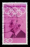MOSCOW, RUSSIA - OCTOBER 21, 2017: A stamp printed in Germany Fe. Deral Republic shows Baron Pierre de Coubertin (1862-1937), Summer Olympics 1968, Mexico City royalty free stock photo
