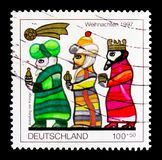 MOSCOW, RUSSIA - OCTOBER 3, 2017: A stamp printed in Germany Fed. Eral Republic shows The Three Kings, Christmas 1997 serie, circa 1997 royalty free stock photos