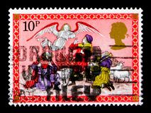 Angel appearing to the Shepherds, Christmas 1979 - Nativity Scenes serie, circa 1979. MOSCOW, RUSSIA - OCTOBER 3, 2017: A stamp printed in Great Britain shows Stock Images