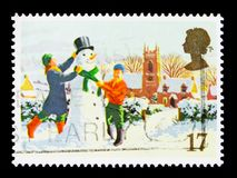Building a Snowman, Christmas 1990 - Christmas serie, circa 1990. MOSCOW, RUSSIA - OCTOBER 3, 2017: A stamp printed in Great Britain shows Building a Snowman Royalty Free Stock Image