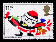 Father Christmas, Christmas 1981 - Children`s Pictures serie, circa 1981. MOSCOW, RUSSIA - OCTOBER 3, 2017: A stamp printed in Great Britain shows Father stock image