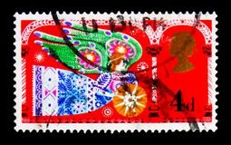 Herald Angel, Christmas 1969 - Traditional Religious Themes serie, circa 1969. MOSCOW, RUSSIA - OCTOBER 3, 2017: A stamp printed in Great Britain shows Herald Royalty Free Stock Images
