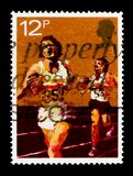 Running, Sport Centenaries serie, circa 1980. MOSCOW, RUSSIA - OCTOBER 3, 2017: A stamp printed in Great Britain shows Running, Sport Centenaries serie, circa Royalty Free Stock Image