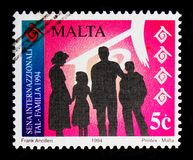 Family in silhouette, Anniversaries and Events 1994 serie, circa 1994. MOSCOW, RUSSIA - OCTOBER 3, 2017: A stamp printed in Malta shows Family in silhouette Stock Images