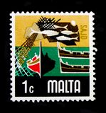 Fishing Industry, Aspects of Malta serie, circa 1973. MOSCOW, RUSSIA - OCTOBER 3, 2017: A stamp printed in Malta shows Fishing Industry, Aspects of Malta serie Stock Images